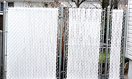 Chain Link Fence with White Slats
